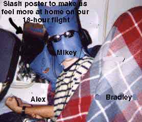alex, poster of slash, mikey, and bradley on the plane